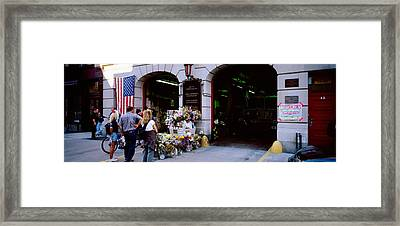 Rear View Of Three People Standing Framed Print by Panoramic Images