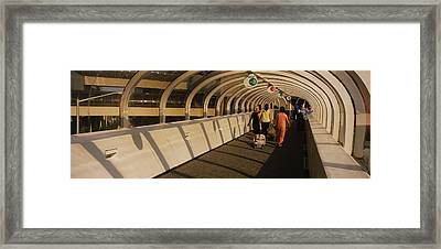 Rear View Of Tourists Walking Framed Print