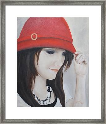Rebecca's Red Hat Framed Print