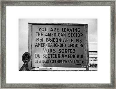 reconstruction of the you are leaving the american sector sign at checkpoint charlie Berlin Germany Framed Print