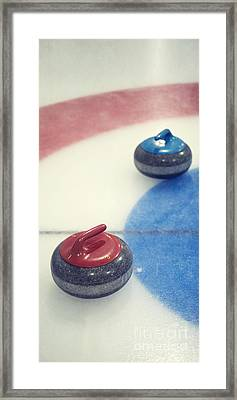 Red And Blue Curling Rock Framed Print by Priska Wettstein