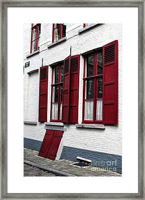 Red And White In Bruges Framed Print by John Rizzuto