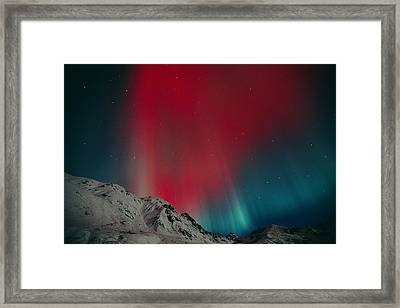 Red Aurora Over Talkeetna Mountains At Framed Print by Greg Hensel