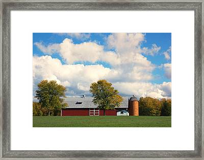 Red Barn And Clouds Framed Print