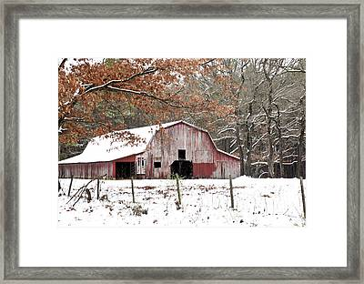 Red Barn In Snow Framed Print by Robert Camp