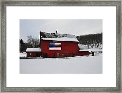 Red Barn With Flag In The Snow Framed Print