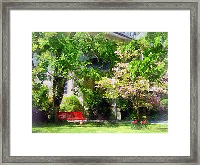Red Bench By Pink Tree Framed Print