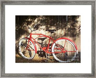 Red Bike Framed Print by Susan Williams