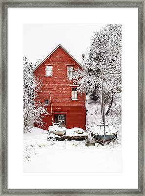 Red Boathouse In The Snow Framed Print by Benjamin Williamson