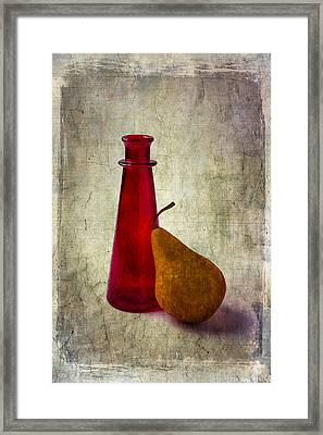 Red Bottle And Pear Framed Print by Garry Gay