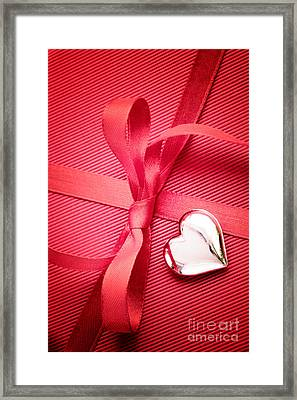 Red Bow On Present Framed Print by Mythja  Photography