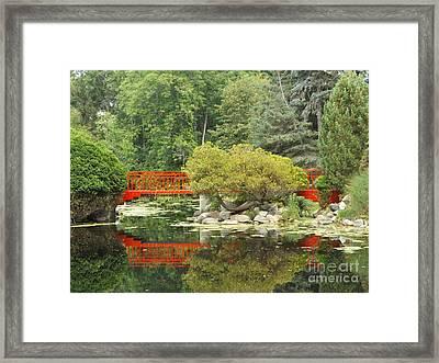 Red Bridge Reflection In A Pond Framed Print by Erick Schmidt