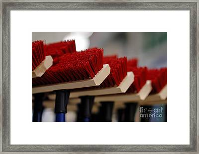 Red Bristled Push Brooms Framed Print by Amy Cicconi