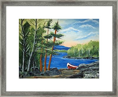 Red Canoe Framed Print by Brenda Brown