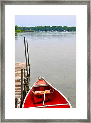 Red Canoe Framed Print by Jeremy Evensen