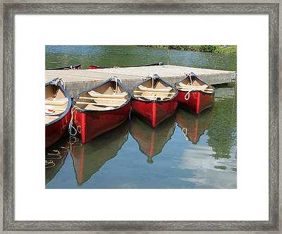 Red Canoes Framed Print by Marcia Socolik
