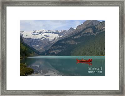 Red Canoes On Lake Louise Framed Print by Teresa Zieba