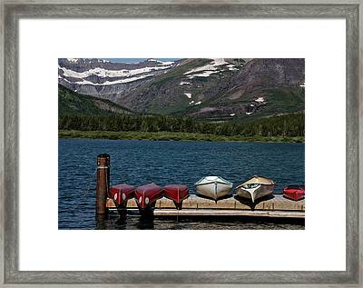 Red Canoes On The Lake Framed Print