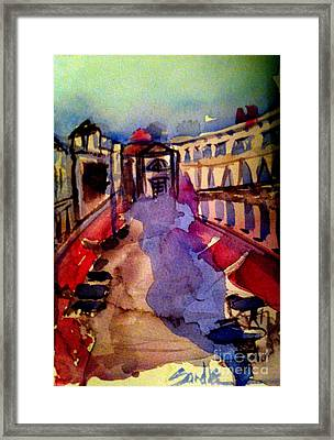 Red Canopies Framed Print by Sandra Stone