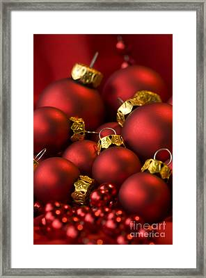 Red Christmas Baubles Framed Print by Anne Gilbert