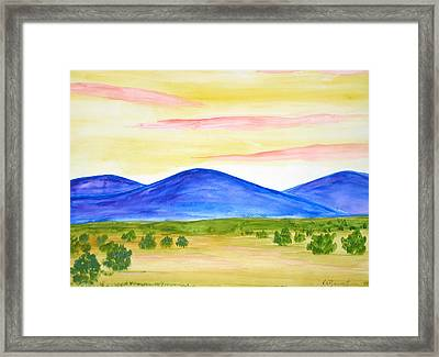 Red Clouds Over Mountains Framed Print