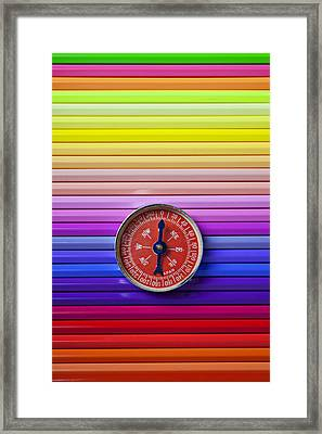 Red Compass On Rolls Of Colored Pencils Framed Print by Garry Gay