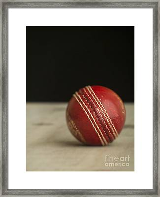 Red Cricket Ball Framed Print by Edward Fielding