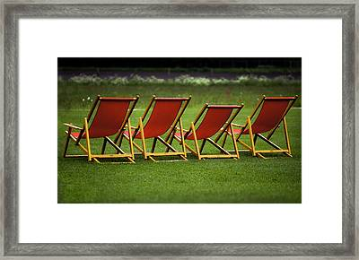 Red Deck Chairs On The Green Lawn Framed Print by Mikhail Pankov