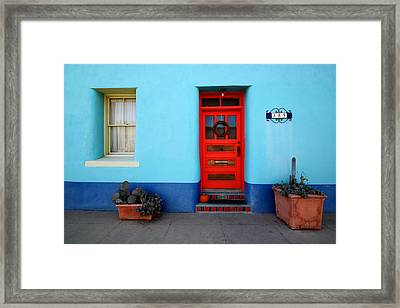Red Door On Blue Wall Framed Print