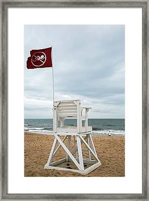 Red Flag At A Beach Framed Print