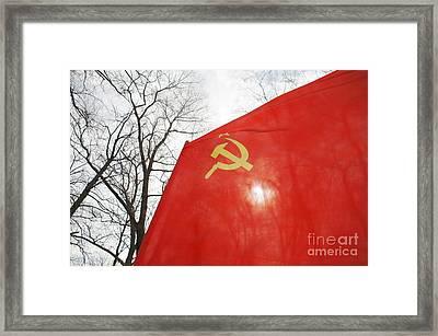 Red Flag Flying Framed Print by Aleksey Tugolukov