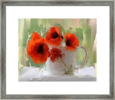 Red Flowers In A Cup Framed Print by Yury Malkov