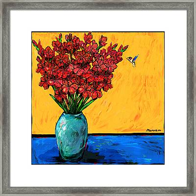 Red Glads With Hummingbird Framed Print by Dale Moses