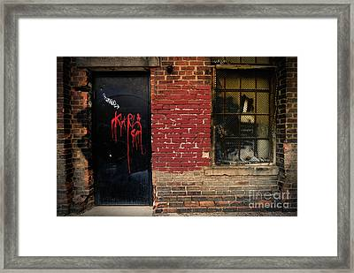 Red Graffiti On Door Framed Print