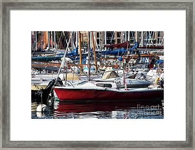 Red In The Port Framed Print by John Rizzuto