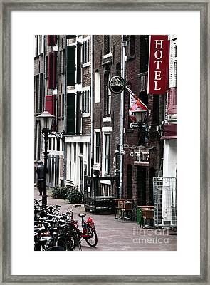 Red Light District Hotel Framed Print by John Rizzuto