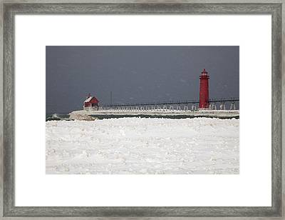 Red Lighthouses - Winter - Stormy Weather Framed Print by John Stephens