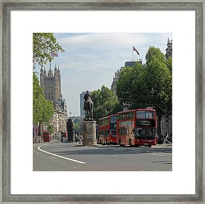 Red London Bus In Whitehall Framed Print by Tony Murtagh