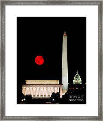 Red Moon Over Monuments Framed Print