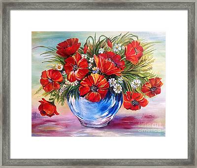 Red Poppies In Blue Vase Framed Print by Iya Carson