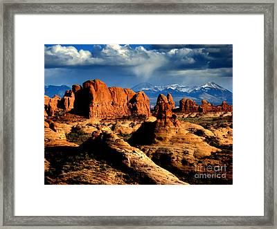 Framed Print featuring the photograph Red Rocks by Irina Hays