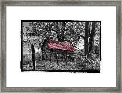 Red Roof Framed Print by Debra and Dave Vanderlaan