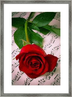 Red Rose On Sheet Music Framed Print by Garry Gay