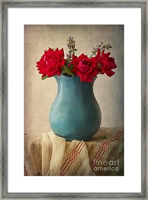 Red Roses In A Blue Pot Framed Print
