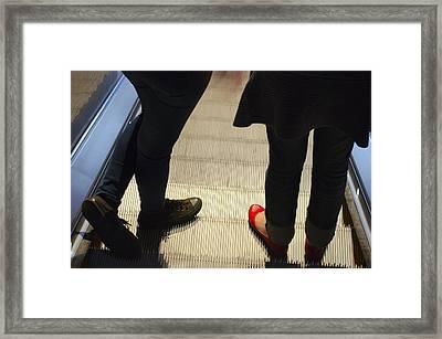 Red Shoe On Escalator Framed Print