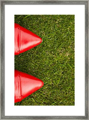 Red Shoes On Grass Framed Print
