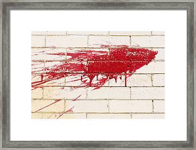 Red Splash On Brick Wall Framed Print