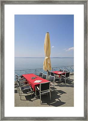 Red Tables Empty Chairs And Blue Sky Framed Print by Matthias Hauser