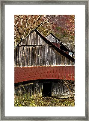 Red Tin Roof Framed Print by Debra and Dave Vanderlaan