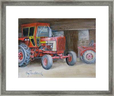 Red Tractor Framed Print by Oz Freedgood